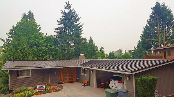 new metal roof, Bellevue WA home, Roof Pros NW sign, Bellevue roofing